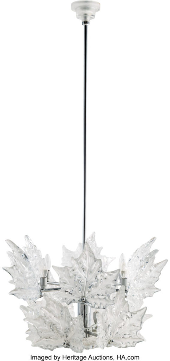 "LaliqueChandelierLaliqueChamps-Élyséeschromed metal and clear and frosted glass chandelier, post-1945, marks:Lalique, France, 53-1/2"" x 21-1/2"" x 21-1/2""; $16,250."