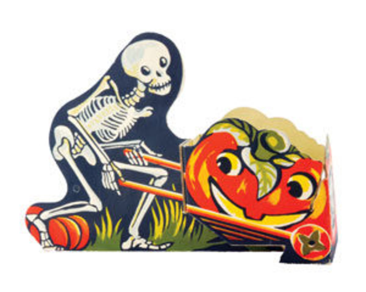 "Skeleton pushing a jack-o-lantern in a wheelbarrow candy holder, USA, G. M. Company, 1950s, 7-1/2"" h x 3"" w x 10-3/4"" l, $375."
