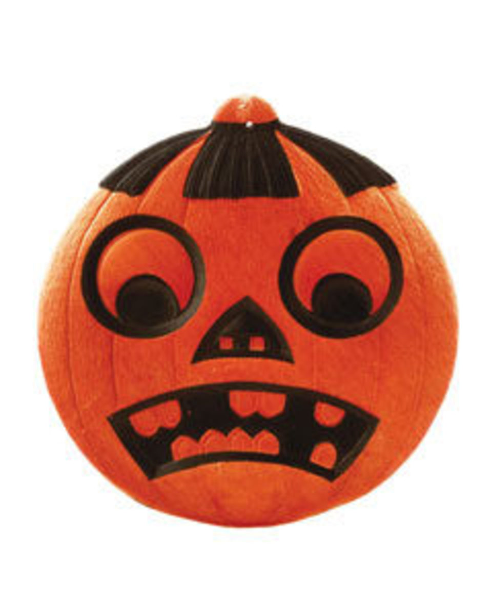 "Jack-o'-lantern with raccoon eyes, Germany, 1920s, 7 1/4"" x 7"", heavily embossed, $185."
