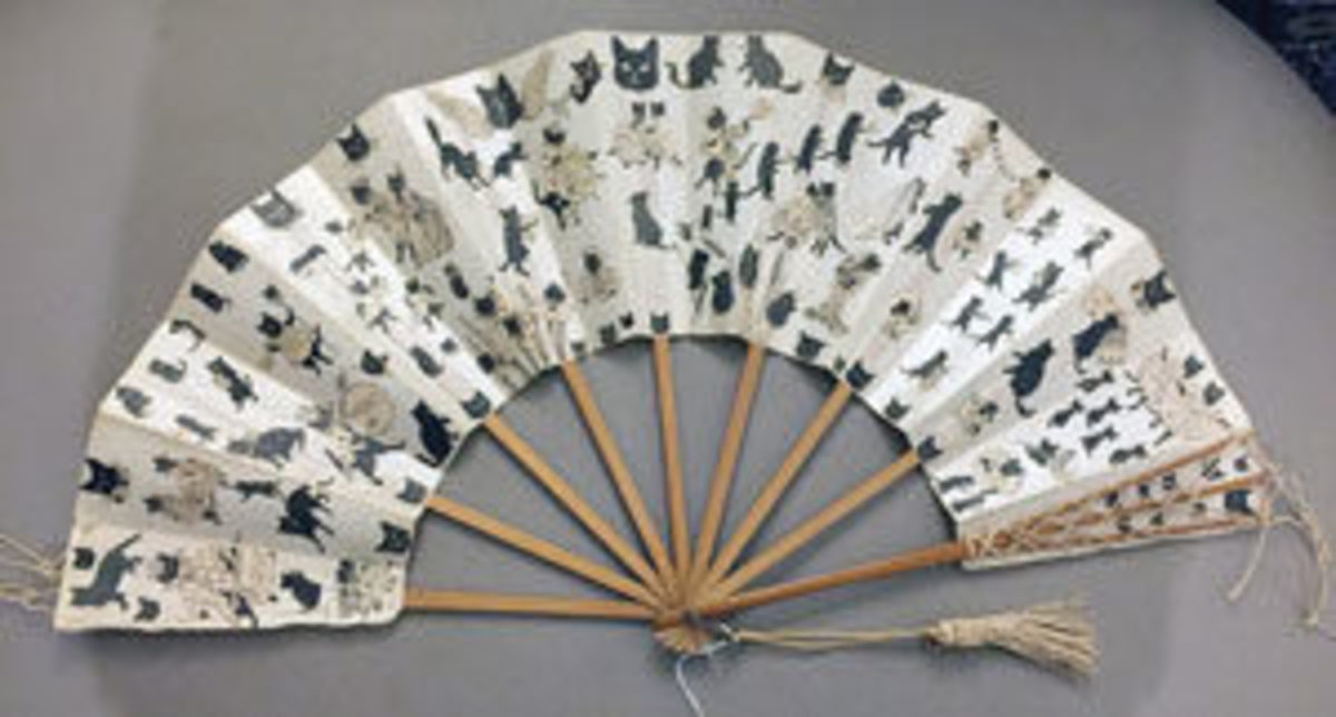 A scrap fan from the 1890s, decorated with cats.