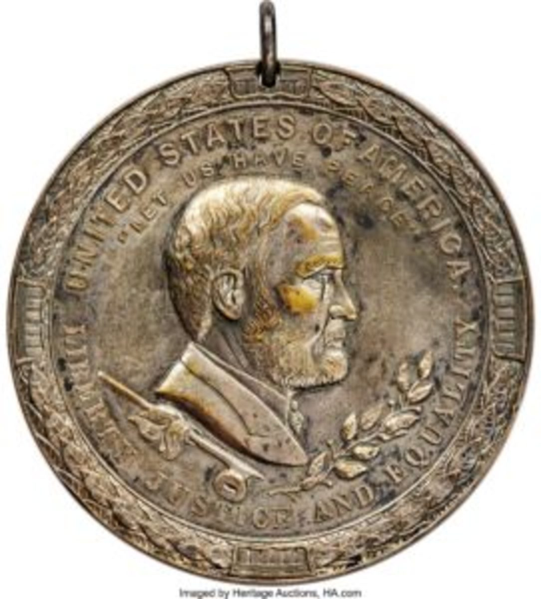 1850 Millard Fillmore Indian Peace Medal in silver, $18,600. Hand-engraved, it was presented to Chief Maungwudaus and dated October 10, 1851. The medal is holed at the top for suspension and the oval loop still remains.