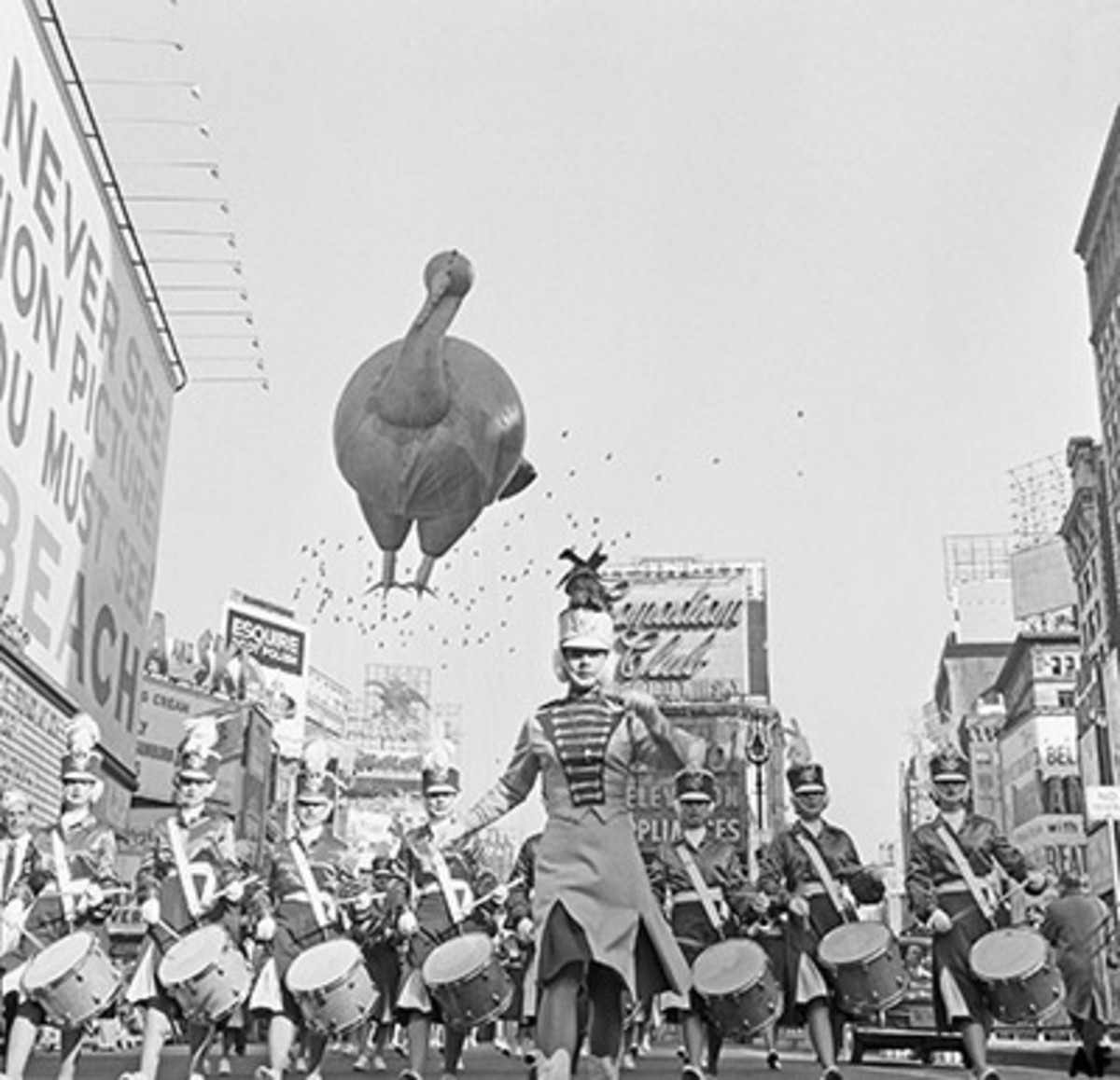 A helium-filled Turkey on it's way through Times Square in 1959, accompanied by a marching band. Photo: Bettmann/Contributor/Getty