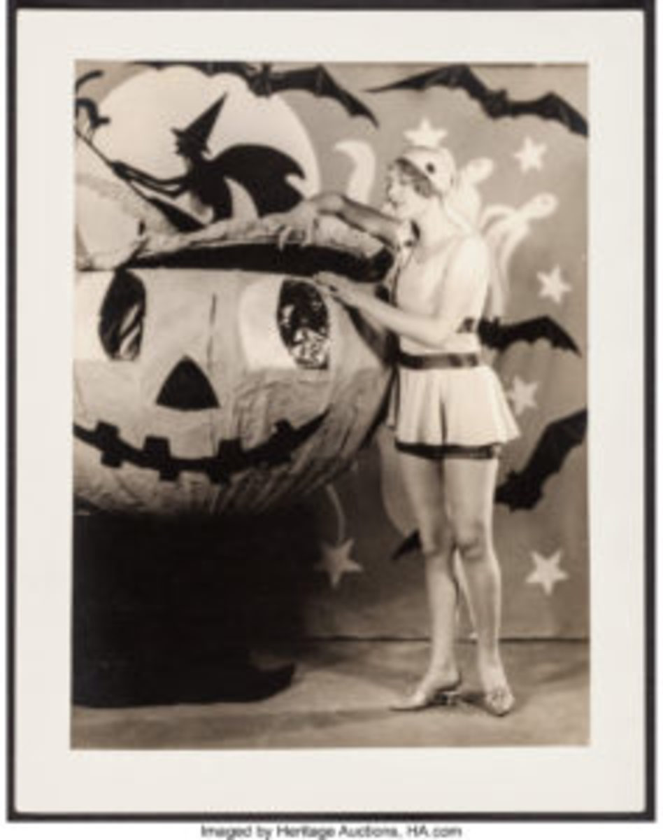 "A playful pinup of Esther Ralston on a spooky Halloween pumpkin set shot by fashion photographer Eugene Robert Richee, Paramount, c. 1920s. Ralston was a silent-screen actress and vaudeville star who was known for a time as ""the American Venus"" for her starring role in the 1926 film of that name."