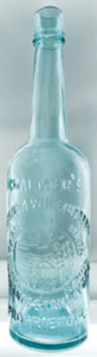 Chalmer's Catawba Wine Bitters, a rare bottle in mint condition and one of only a dozen known, in the shape of a whiskey blown exclusively in aqua, circa 1872-1873; estimate: $10,000-$20,000.