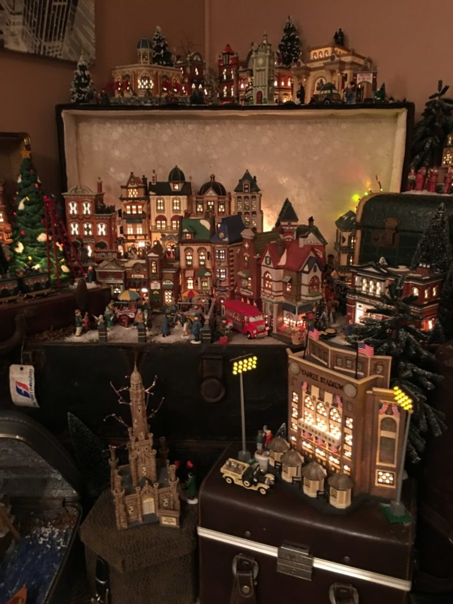 "One of longtime Department 56 collector Brandon Taylor's favorite home displays is the popular ""Christmas in the City"" display, which he showcases in old steamer trunks. Image courtesy of Brandon Taylor"