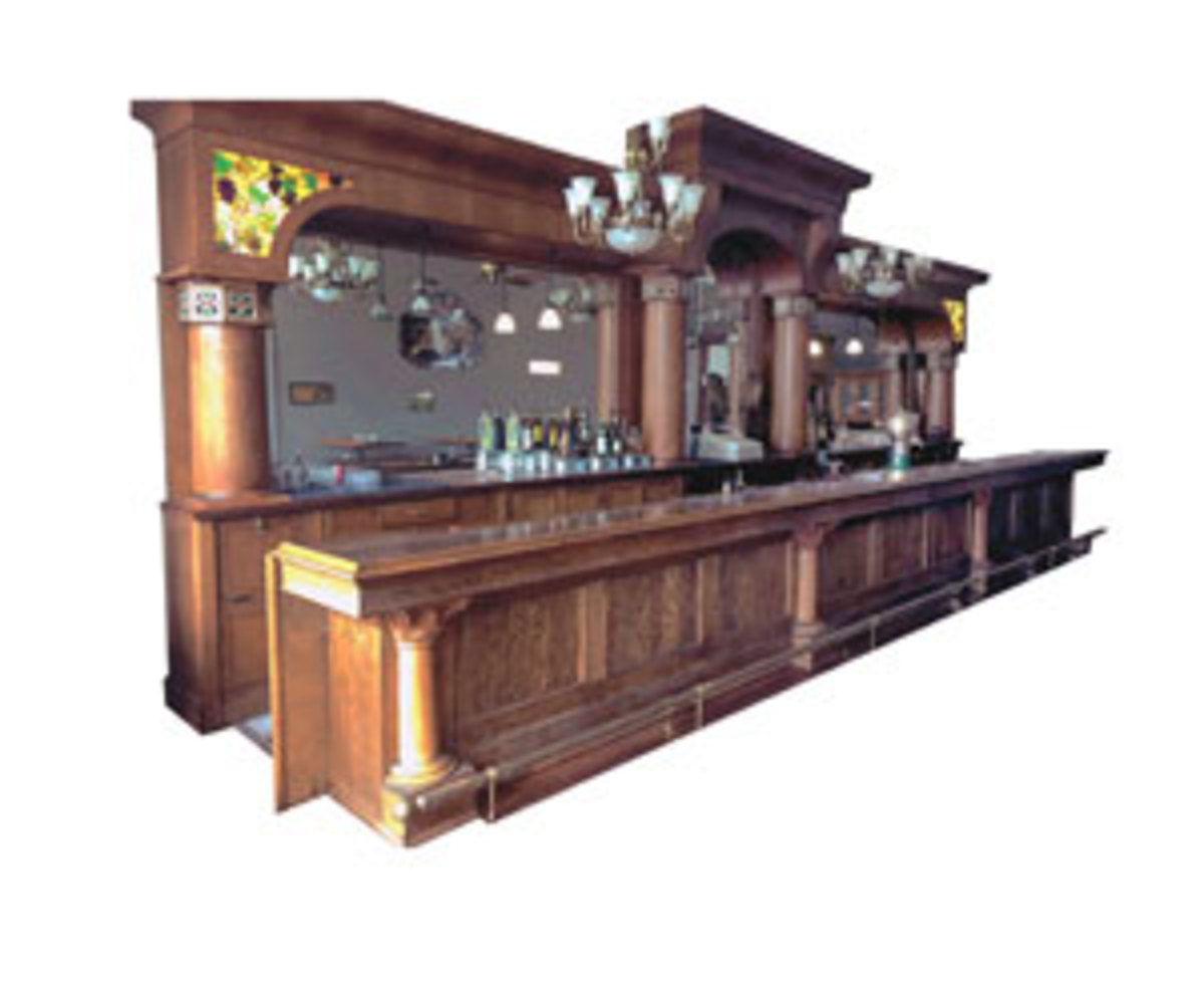 This triple-arch bar, manufactured by The Brunswick-Balke-Collender Co. of New York and Chicago, circa 1900, is one of the featured lots at Donley Auctions Fall Classic Nov. 14-16. The beautiful oak and leaded glass-lit ensemble, 30' x 12', would be the centerpiece of any business or home party room. Estimated value is $40,000-$50,000. Image courtesy of Donley Auctions