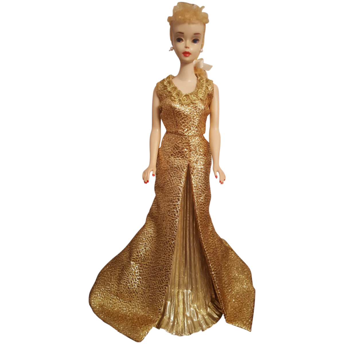 Barbie remains the queen of dolls. Vintage #3 Blonde ponytail Barbie Doll with brown liner and looking glamorous in her gold gown; $795. Courtesy of Old is New: rubylane.com/shop/vintage-finds