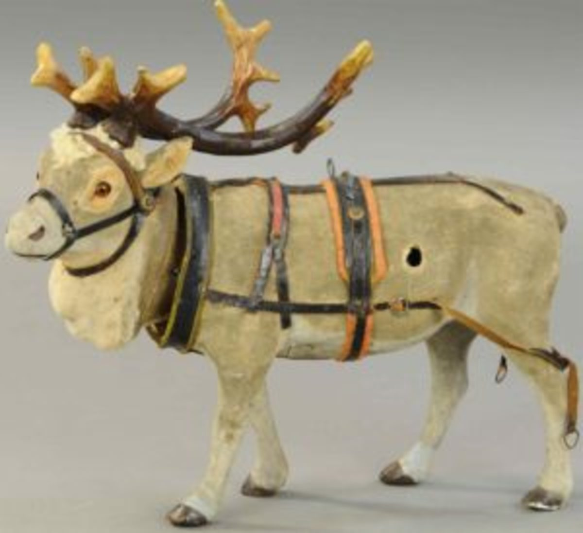 "This nodding reindeer sold for $9,600 at Bertoia's recent auction of the Sam Downey, Jr. collection — nearly three times its high estimate of $3,500. Made in Germany, the reindeer has brown glass eyes, composition antlers, full leather harness and collar, and is ready to pull Santa's sleigh. This is a hard-to-find example in good working order; 12"" h."