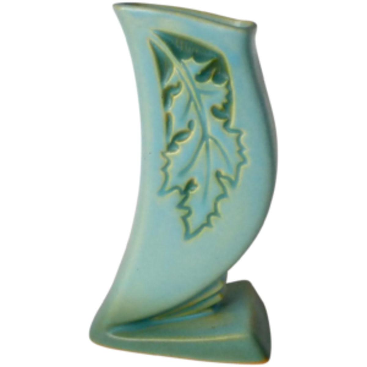A beautiful Roseville pottery Oak Leaf Silhouette Vase has the theme of fall, but is in an unexpected color of a lovely blue green matte glaze. The graceful shape has an unusual stepped design at the base, the curved body has a delicate silhouette of an oak leaf on both sides; $125. Courtesy of Bejeweled: rubylane.com/shop/bejewelled