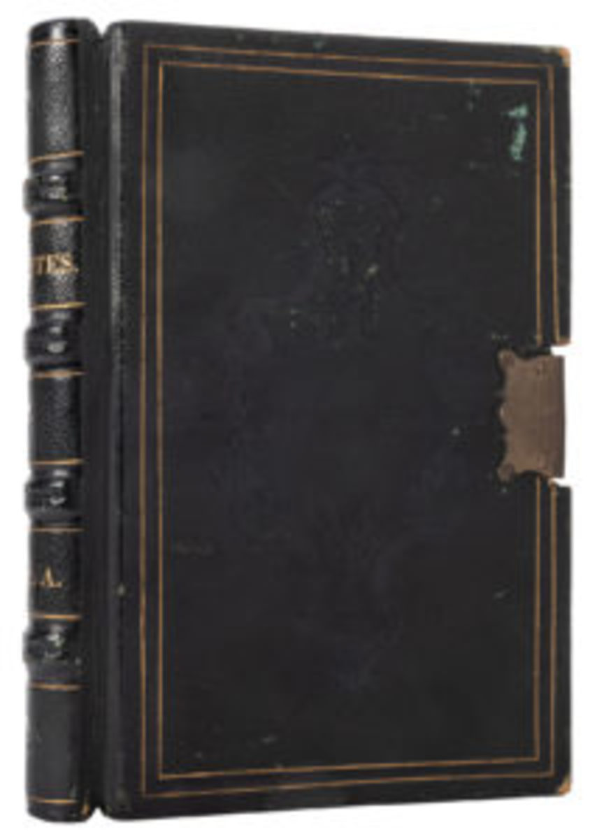 The top lot at Potter & Potter's Winter Magic Auction is this Houdini-Slade-Weiss Locked Book. The tome was created by Remigius Weiss and used in a trial to expose Henry Slade, a supposed spirit medium. Years later, Weiss gave the book to his friend and fellow spiritualism researcher and debunker, Harry Houdini. The 19th century tooled black leather volume is accompanied by a handsomely framed collage of Houdini memorabilia at top right. Estimate: $10,000-$15,000.
