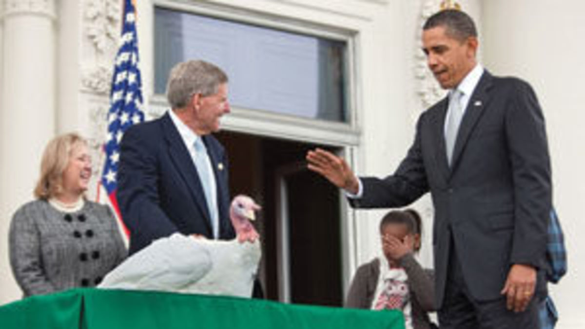 President Barack Obama pardoning a turkey named Courage in 2009.