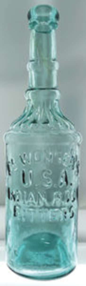 Wonser's USA Indian Root Bitters, an unusually shaped early San Francisco bottle in a bright aqua coloration, circa 1871-73, one of a dozen aqua examples known; estimate: $10,000 to $15,000.