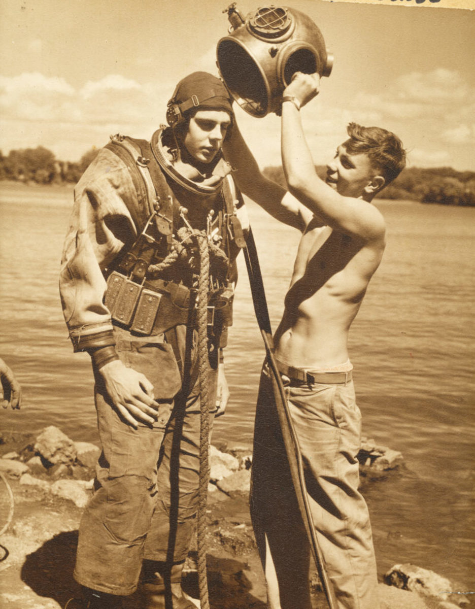 A diver gets a hand from his brother while suiting up on the shores of Cedar Lake in Minnesota in 1947. The helmet, made by A. Schrader's Son, dates to the 1910s. It, as well as other gear, was part of a family operation.