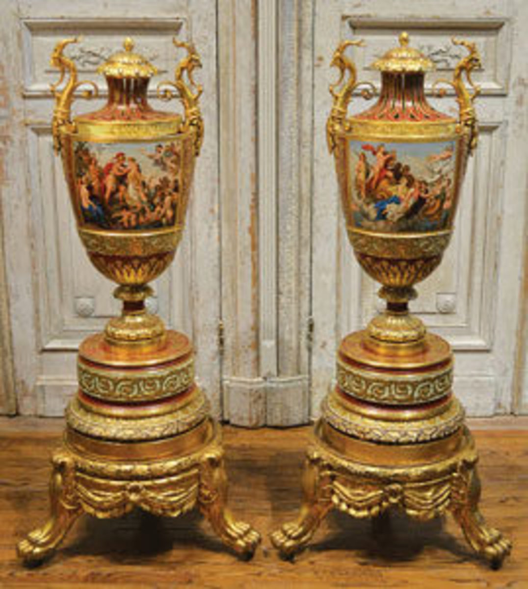 Pair of circa 1890 Royal Vienna urns, monumental in size at 57 inches tall each (on stands), with each capped urn surmounted by a large antlered gargoyle handles; estimate: $35,000-$45,000.