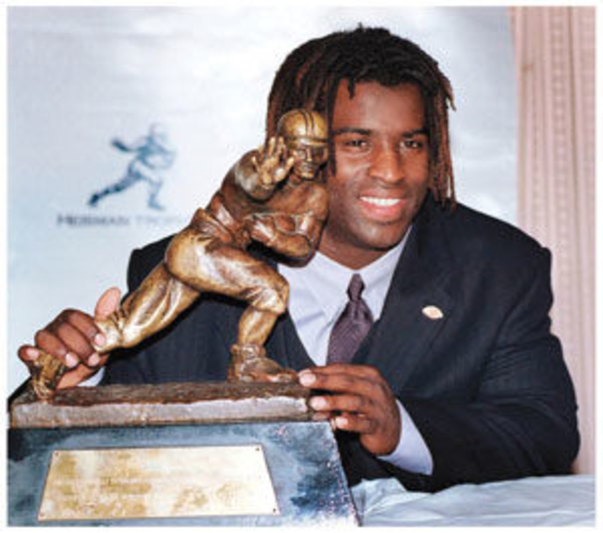 Ricky Williams with his Heisman Trophy in 1998. Image courtesy Heritage Auctions