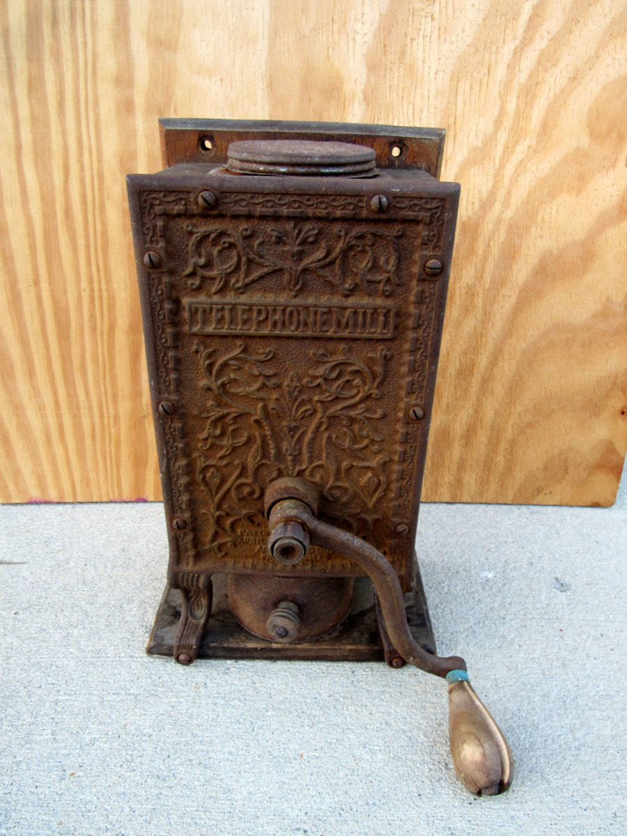Heavily rusted coffee grinder.