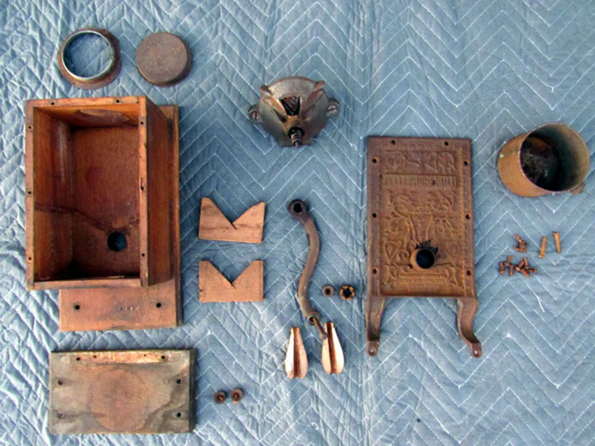 All of the pieces of the restored coffee grinder Lewis took apart. He documents each step with photos, in case he ever forgets how to put it back together.