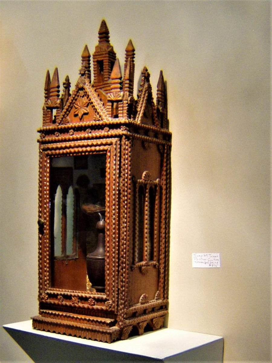 Visitors to the York Antiques Show & Sale in York, Pa., can expect to see folk art like this chip-carved display case.