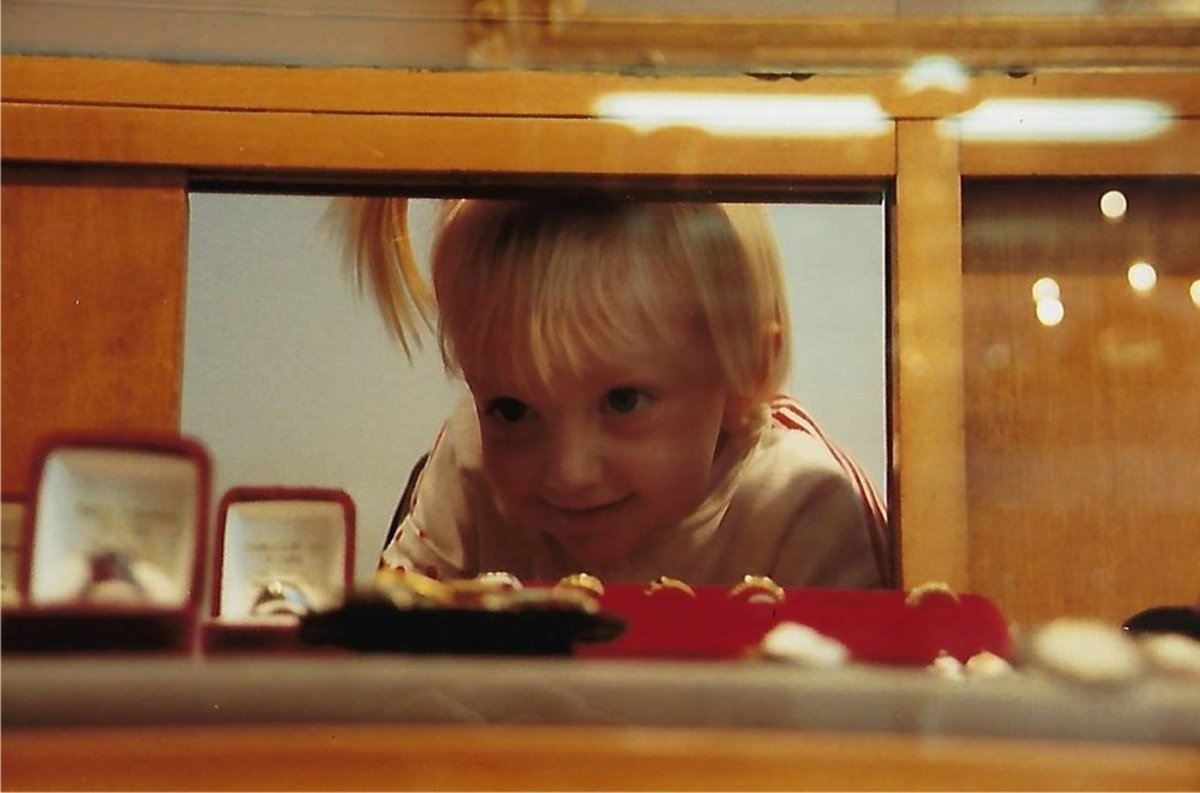 Third-generation owner Julie Walton Garland grew up in the business. Here she is pictured at age four looking at jewelry inside the store.