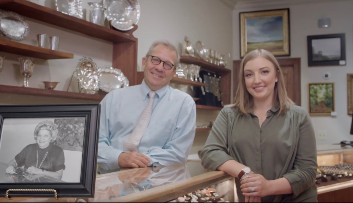 Mike Walton and his daughter, Julie Walton Garland, with a photo of Melba, Walton's Antique and Estate Jewelry's late founder — three generations of Waltons.