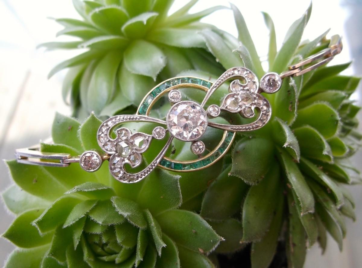Edwardian-era, old-European-cut diamond and emerald detail bracelet set in platinum topped gold with a 1.15 carat old-European-cut diamond in the center.