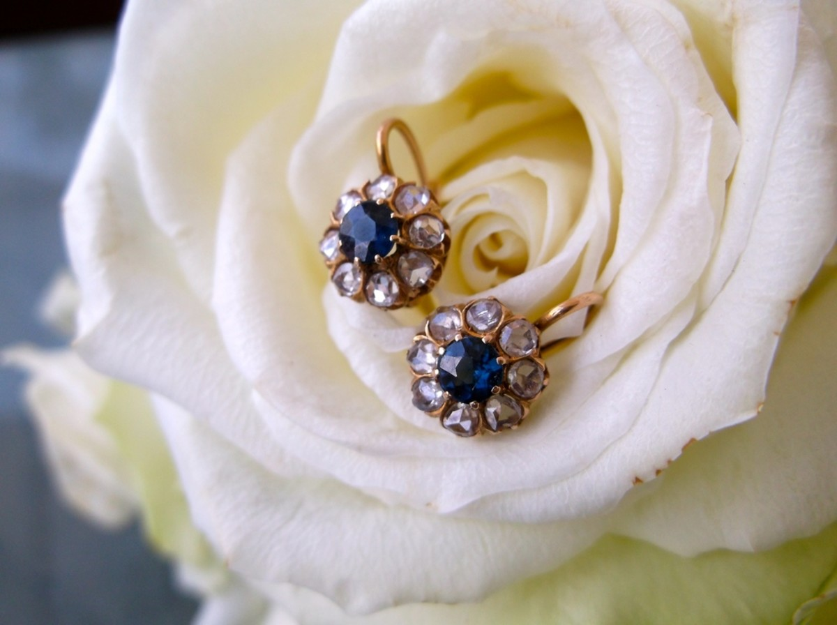 Victorian-era, rose-cut diamond and sapphire dainty drop earrings set in yellow gold.