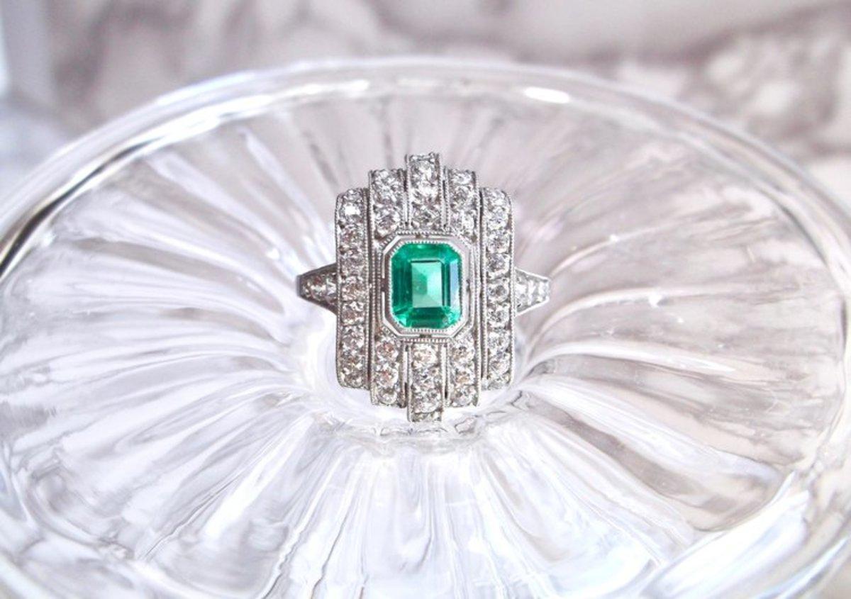 Art Deco emerald, diamond and platinumring.