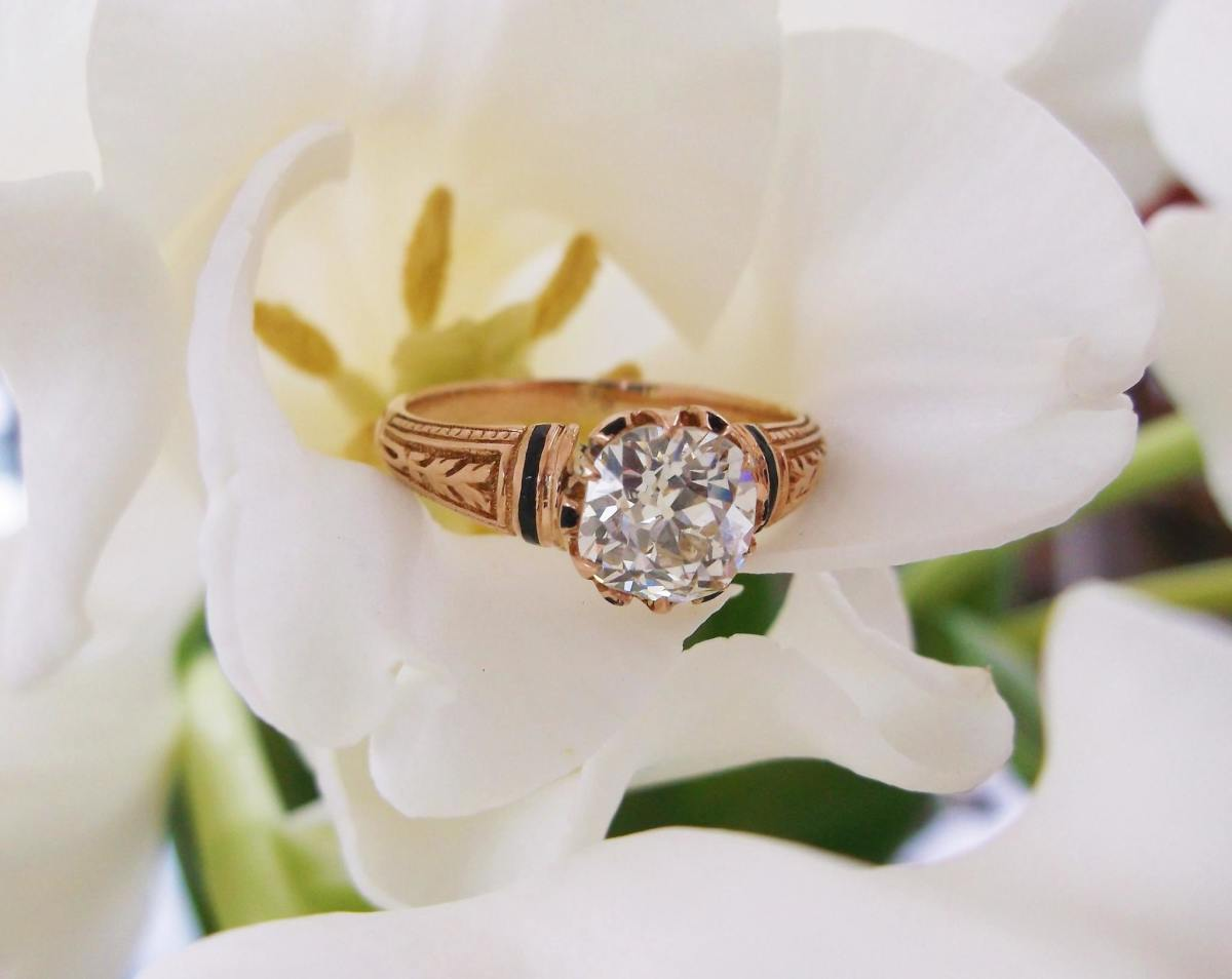 Victorian-era, old-mine-cut diamond ring set in yellow gold with black enameling details.