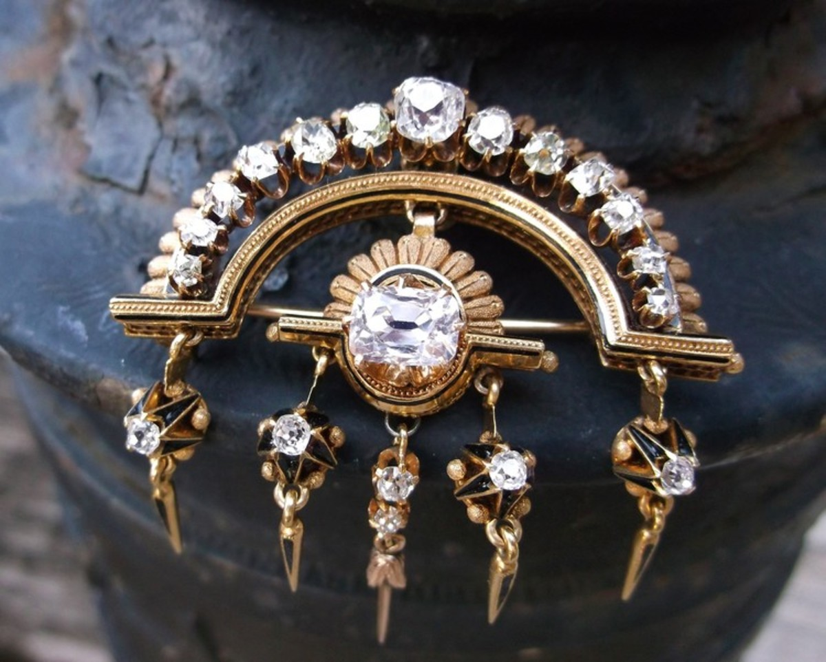 Victorian-era, old-mine-cut diamond, yellow gold and black enamel pendant that doubles as a brooch.