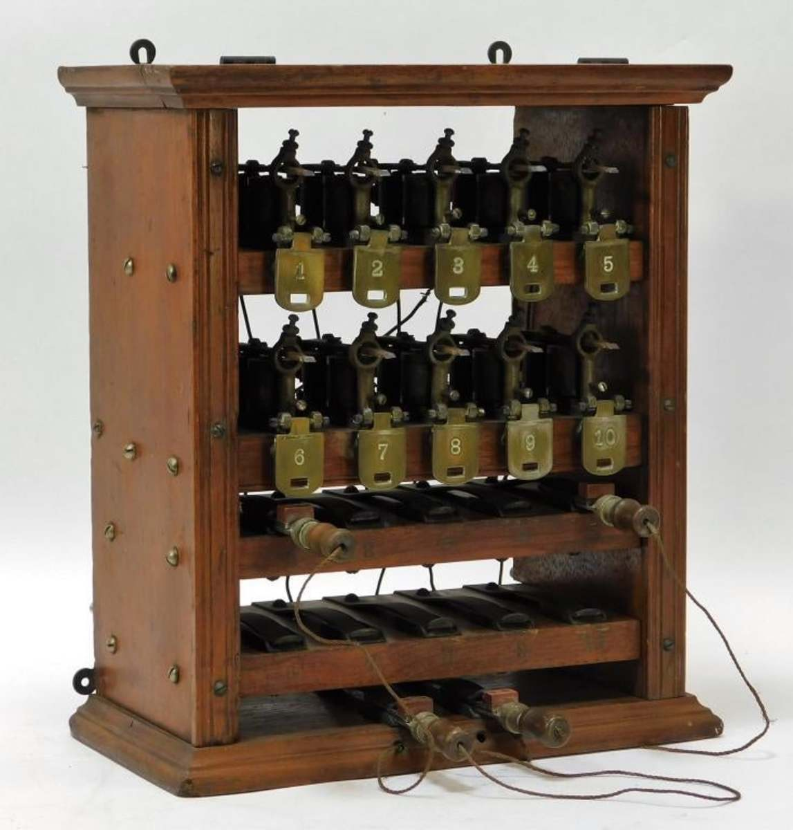 "Fifty-six bidders vied for this mahogany telephone switchboard box, United States,19th century. unidentified company, from the collection of the New Jersey Telephone Pioneers of America Museum. Overall 12-3/4"" x 11-1/4"", $11,000 (est: $200-$300)."