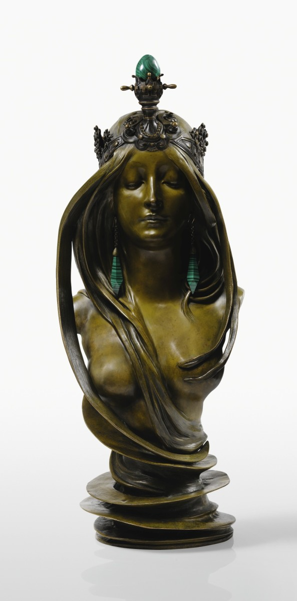 "Mucha's ""La Nature"" sculpture in patinated bronze and malachite, circa 1900, signed Mucha, with foundry mark Pinedo Paris and stamped Bronze Garanti au Titre - Paris, 27-1/2"" x 10-5/8"" x 11"". It sold at Sotheby's for $752,548, far above its estimate of $503,564 to $615,467."