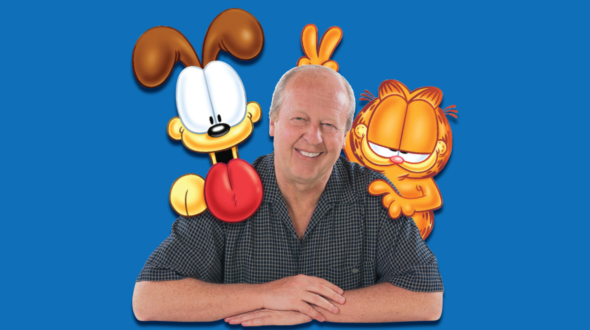 Cartoonist Jim Davis with his pals Garfield and Odie.