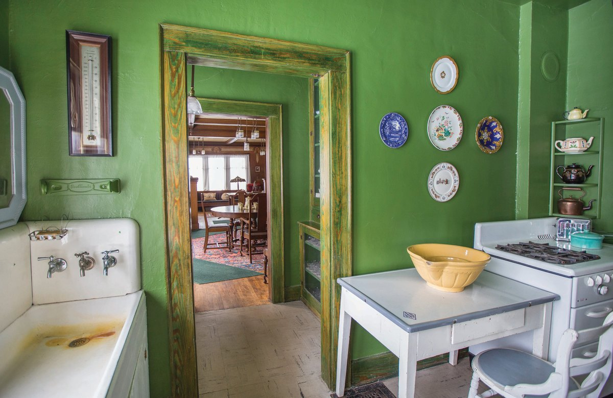 Little has changed since the house was built. A brilliant green wall color is the only refinement in the kitchen.