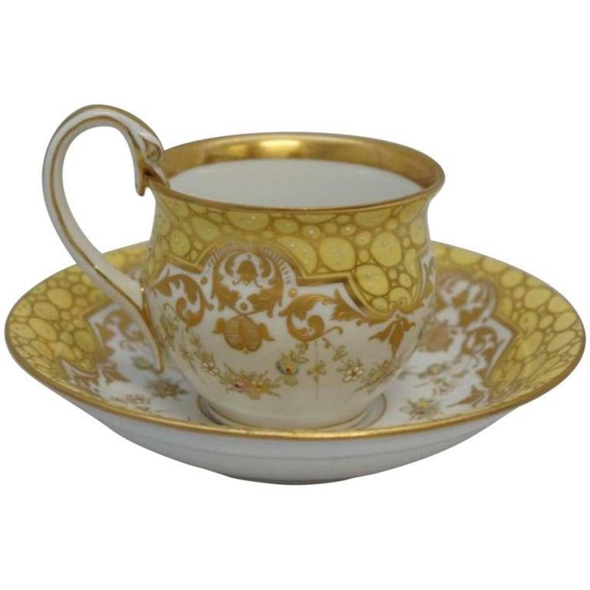 """Meissen swan-handle teacup and saucer set, heavy enameled floral swags and accentswith heavy gilt, cup is 3"""" d x 2-1/2"""" h; saucer is 5-1/2"""" d x 1-1/4"""" h, $700."""