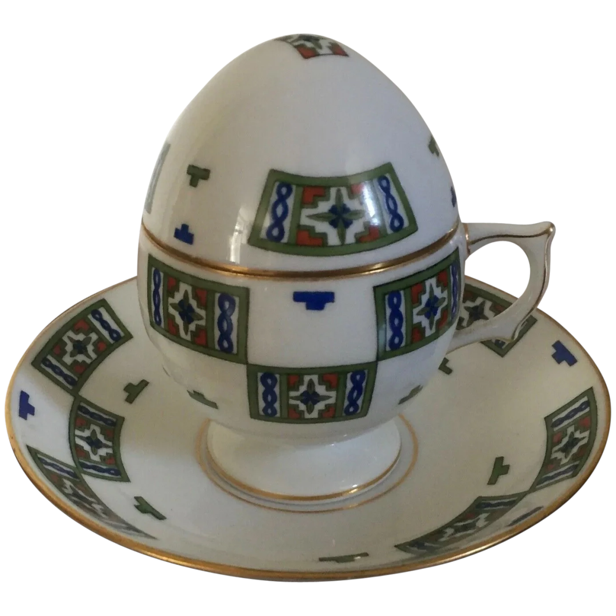 """Russian Kornilow Brothers Tsarist porcelain Imperial Russian egg teacup, cover and saucer, 1900-1910, Aesthetic design. Saucer is 5-1/8"""" dia; cup is 4"""" h, including the lid, $1,295."""