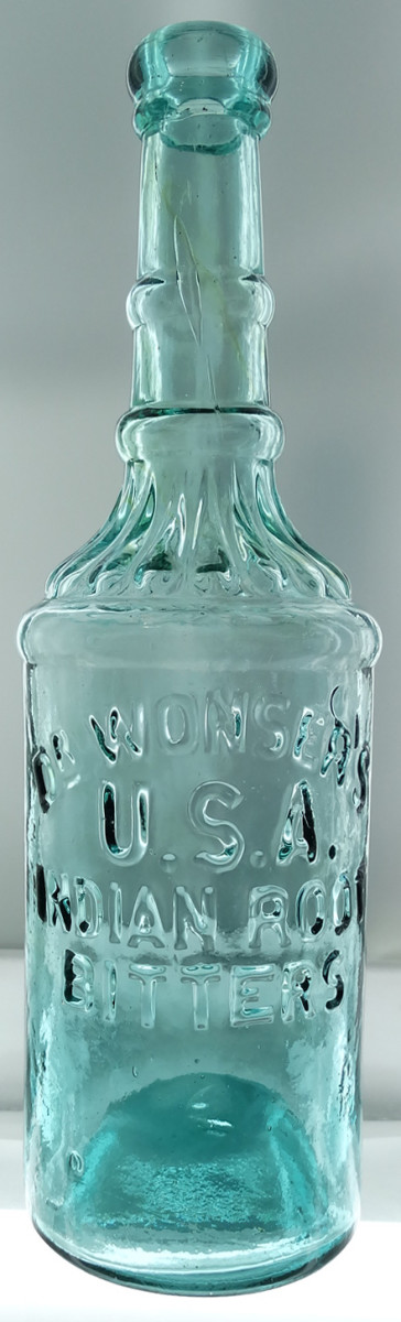 Wonser's USA Indian Root Bitters, an unusually shaped early San Francisco bottle, bright aqua, circa 1871-73, one of a dozen aqua examples known, $25,300.