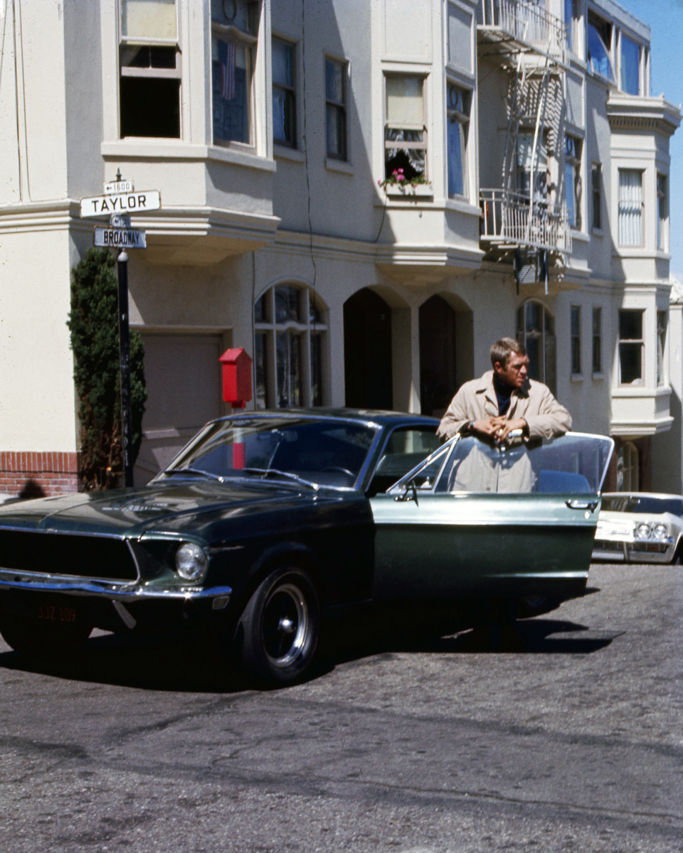 Steve McQueen as Frank Bullitt with the most famous Ford Mustang of all time, driven by McQueen in the 1968 crime thriller Bullitt.