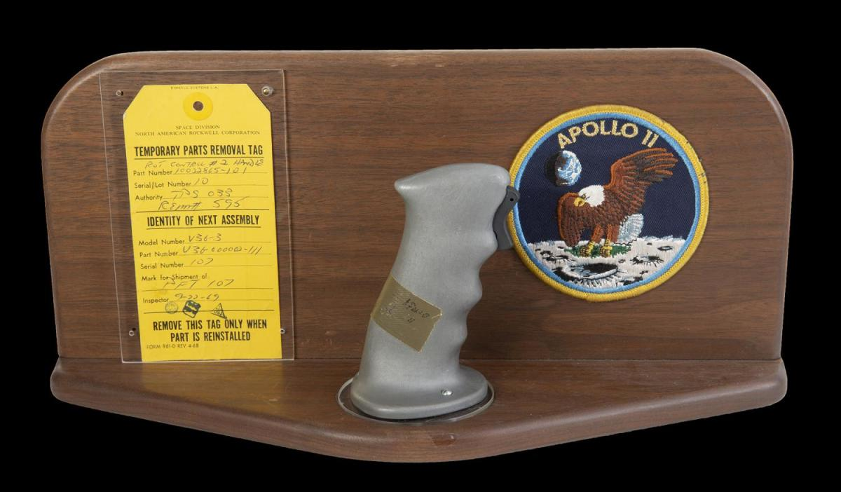 A Neil Armstrong used pilot control stick from Apollo 11 sold for $370,000 at Julien's Auctions.