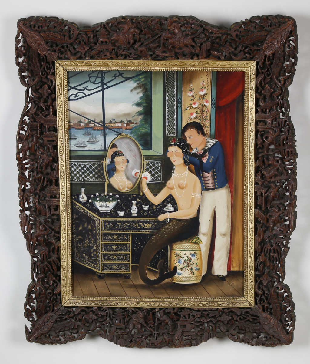 "Ralph Eugene Cahoon Jr. (1910-1982) oil on Masonite ""Sailor's Surprise,"" a Chinese export interior scene with sailor and his mermaid sitting at her chinoiserie dressing table overlooking the Hongs at Canton, China, in a most exceptional carved and gilt Chinese export period frame, circa 1800; 24-1/2"" x 20-3/4"" overall. Estimate: $50,000-$60,000."