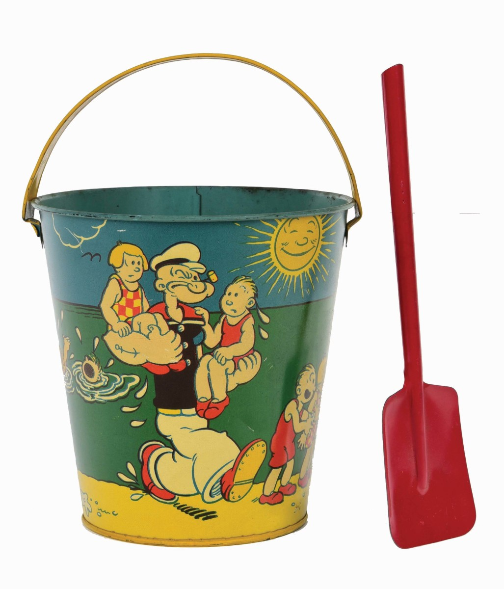 """This scarce Popeye tin litho sand pail and scoop by Chein had 21 bidders after it. It shows great scenes of Popeye rescuing kids from the water and the other side shows him handing them a sand pail. Marked """"J. Chein & Co. USA"""" and """"Copyright 1932 King Features Syndicate Inc.""""; 6"""" x 6"""" x 6"""", $1,722."""