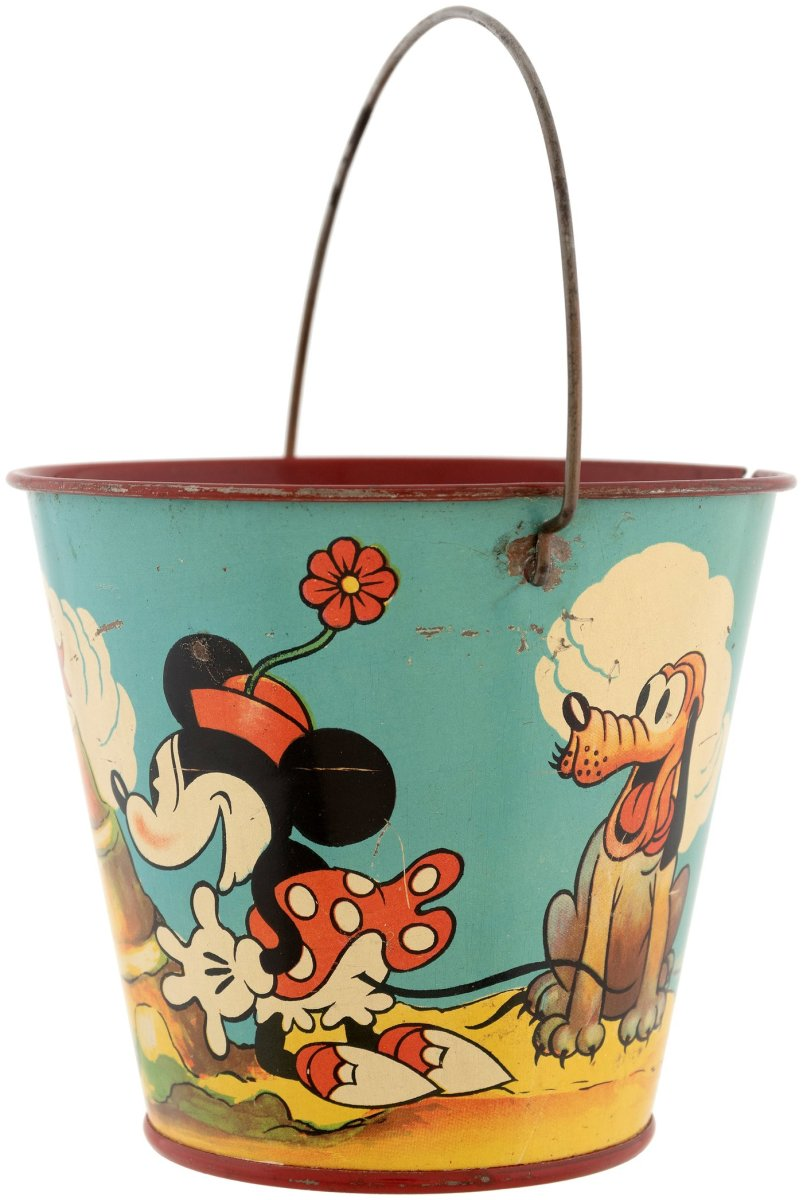 Another side of the sand pail shows Minnie and Pluto watching them build the castle.