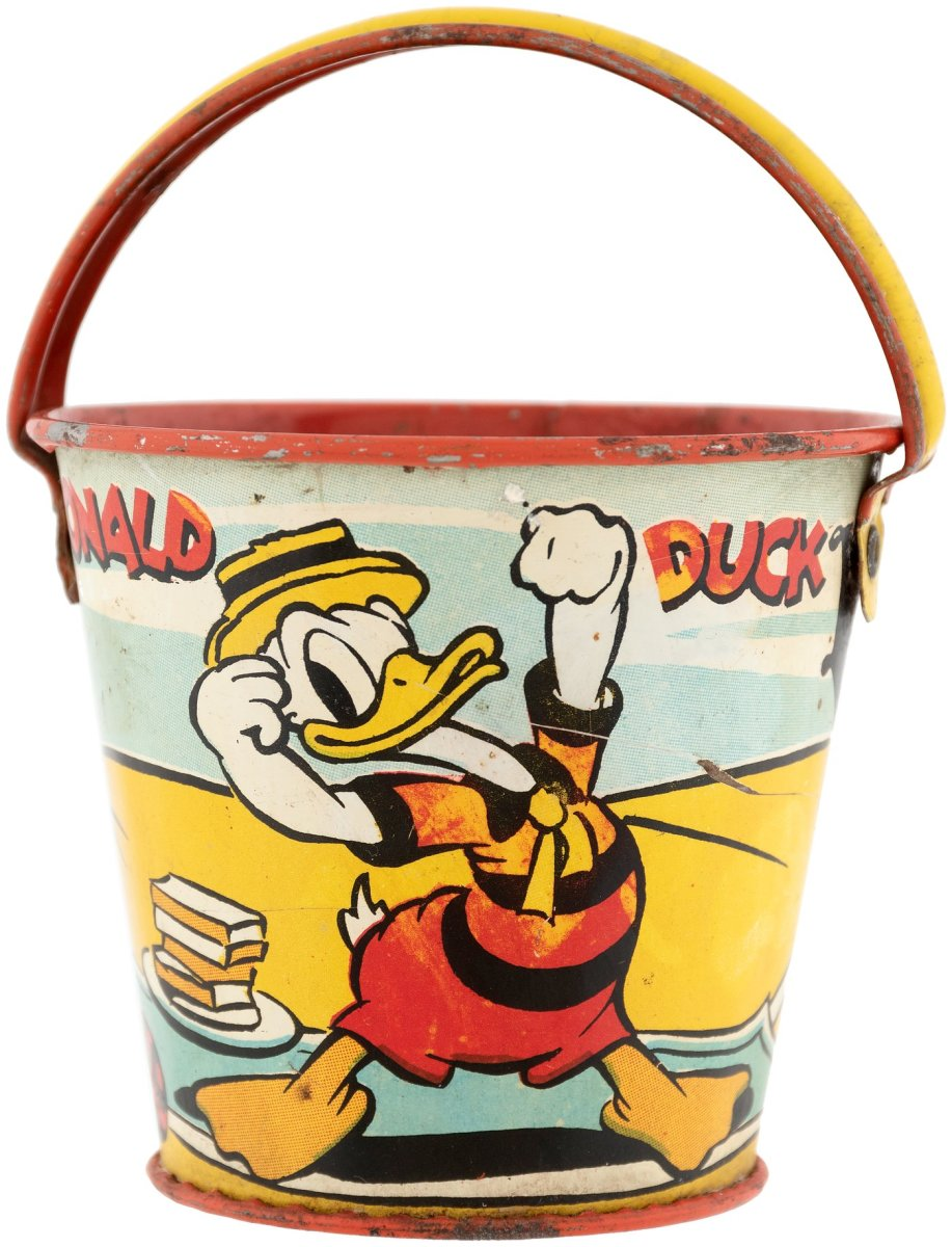 """Small tin litho Donald Duck pail, Ohio Art, 1939, 2-7/8"""" h (4-1/2"""" h to top of raised handle); $100."""
