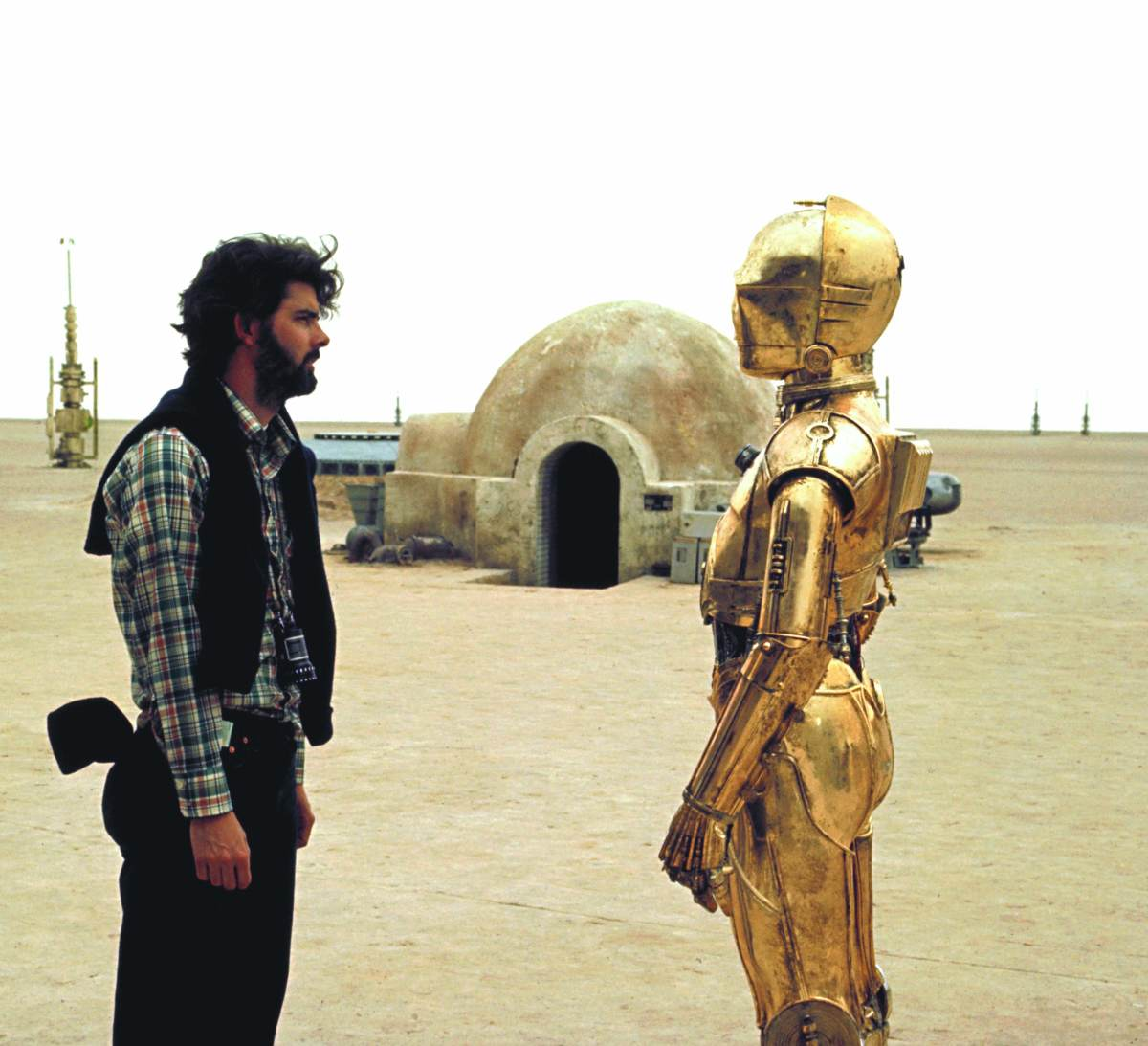 George Lucas with Anthony Daniels as C-3PO during the filming of Star Wars.