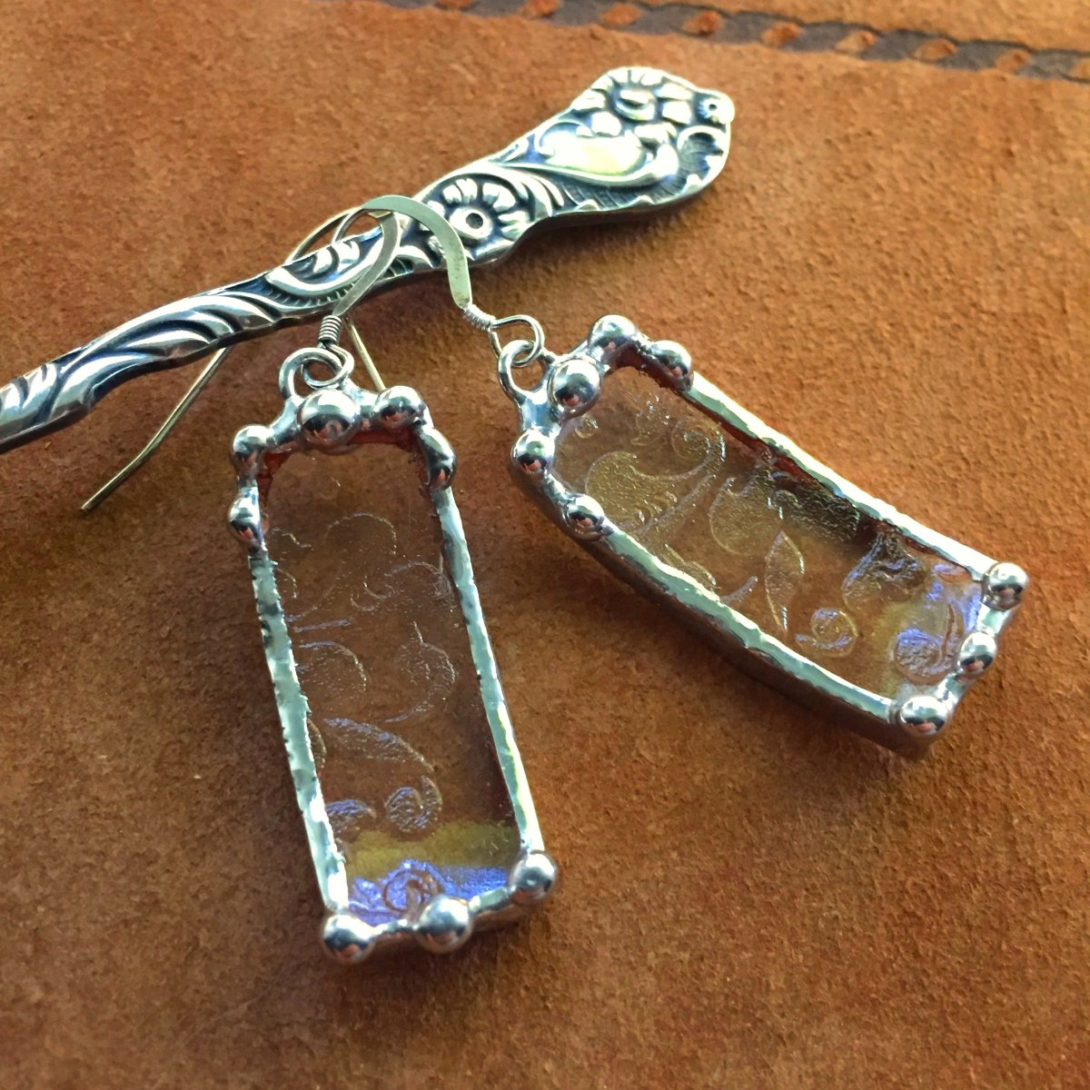 A pair of earrings crafted from Depression glass.