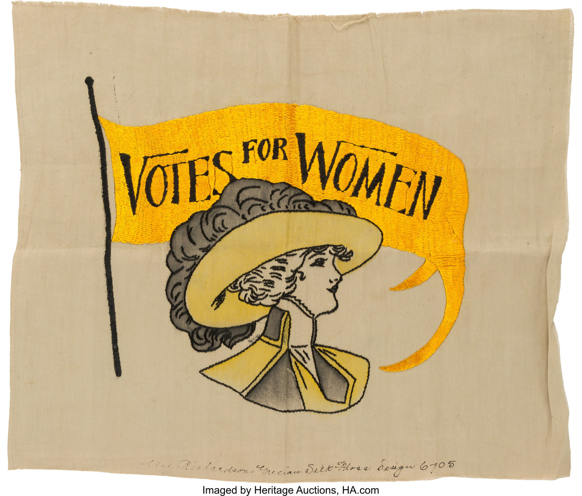 """A suffragette embroidery panel, with silk embroidery of a stylish young woman beneath a large swallow-tail pennant that reads, """"Votes For Women."""" Inscribed on bottom edge: """"Elsa Richardsons Grecian Silk Floss Design 6705,"""" 20"""" x 16-1/2""""; $8,125."""