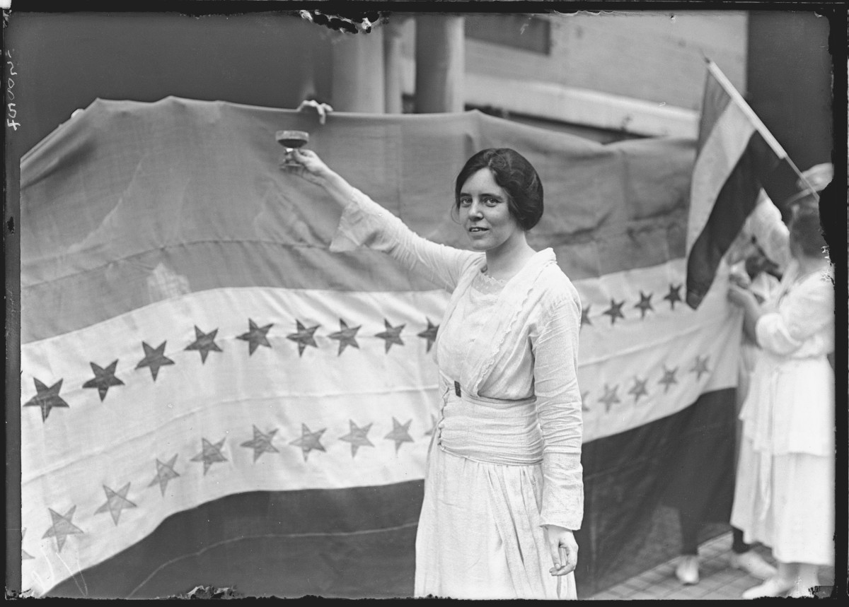Alice Paul, a leader of the 20th century women's suffrage movement, who advocated for and helped secure passage of the 19th Amendment, makes a toast to Tennessee's ratification of the amendment. The banner beside her was displayed outside the National Women's Suffrage Party's Washington, DC, headquarters, showing the stars of the states which had ratified the amendment. Since the 18th amendment, Prohibition, had previously been passed, the toast was with grape juice.