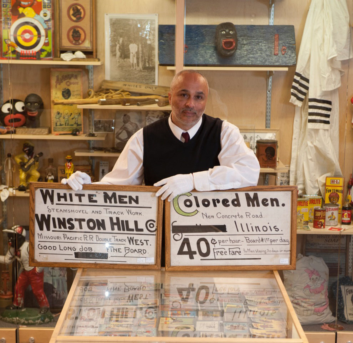 Dr. David Pilgrim, shown with items from the Jim Crow Museum of Racist Memorabilia