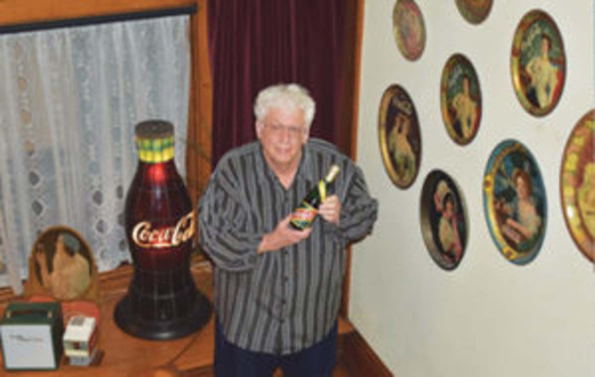 """Bill Bateman, member of the Coca-Cola Collectors Club International, who helped secure permission to use """"Coca-Cola"""" in the club's name, shows off part of his collection. Courtesy of Bill Bateman"""