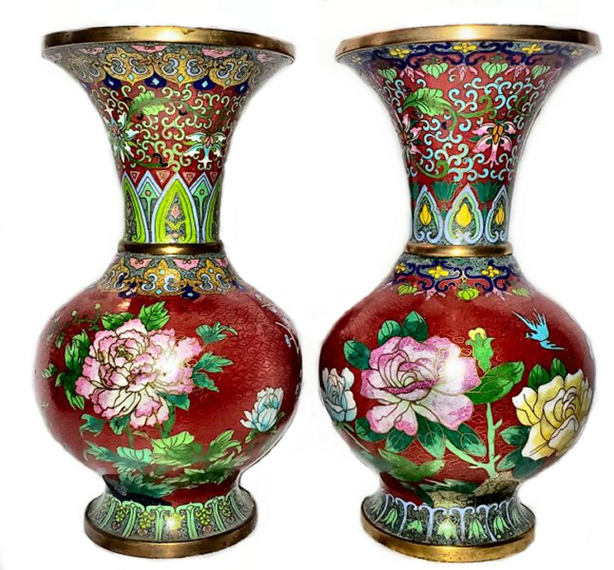 The enameling in cloisonné is overall, whereas the enameling in champlevé is done in well delineated areas. In this pair of large cloisonné vases, the base metal is clearly visible at the base and rims.