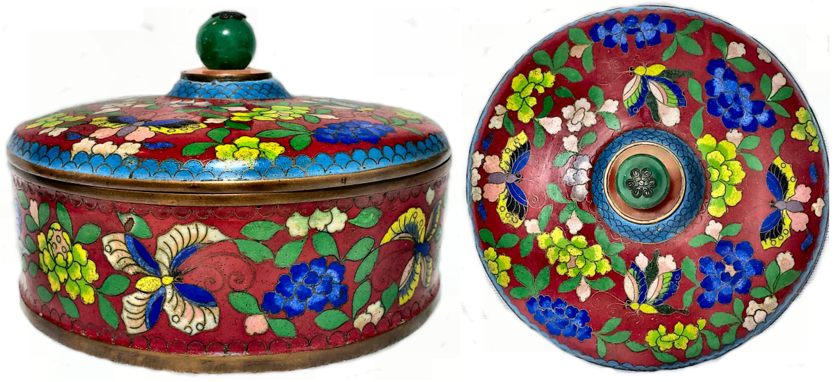 This cloisonné box with a green jade knop depicts a variety of flowers and butterflies. The peonies, the floral symbol of China, symbolize riches, honor, good fortune and a happy marriage. The butterflies symbolize immortality, grace, conjugal bliss and romanticism.